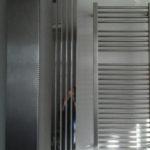 вертикальные радиаторы отопления интерьер фото